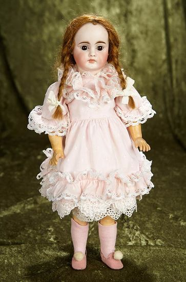 "15"" Beautiful German bisque closed mouth doll in appealing petite size. $700/900"