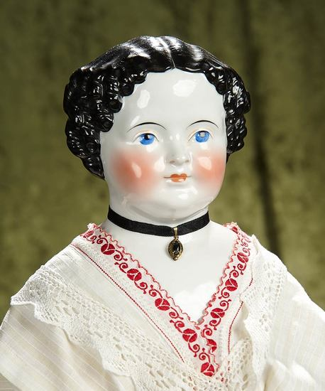 """28"""" German porcelain doll with black sculpted hair and antique costume. $400/500"""