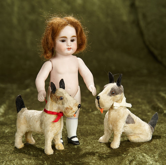 "7 1/2"" German all-bisque doll by Kestner with two little pet dogs. $300/400"