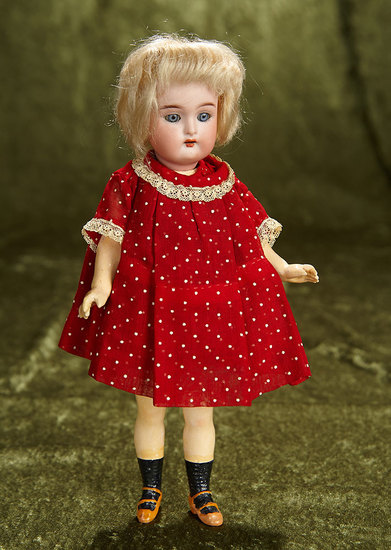 "9"" German bisque flapper doll, walking style doll and original wig, Kammer and Reinhardt. $300/500"