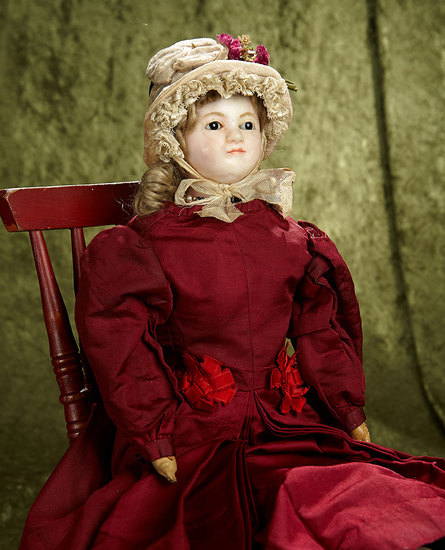"24"" English wax doll with endearing expression, lovely antique costume and bonnet. $500/700"