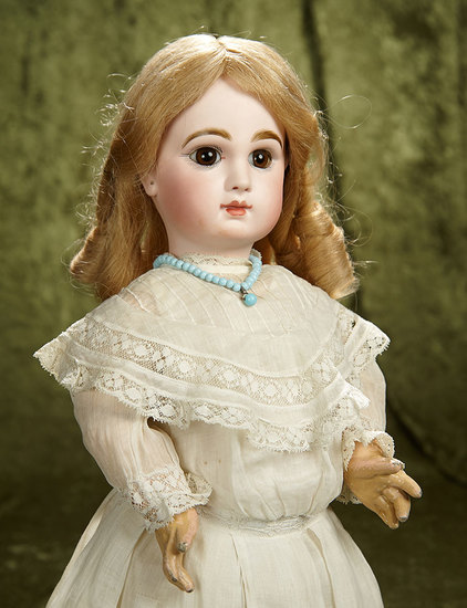 "19"" French bisque brown-eyed bebe by Emile Jumeau with original signed body. $2800/3200"