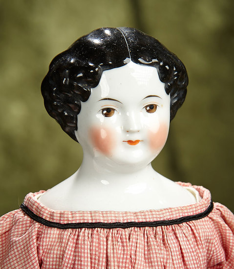 "17"" German porcelain doll with rare brown painted eyes. $400/500"
