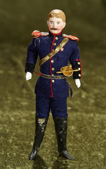 "7"" German bisque dollhouse soldier in original uniform with sword. $400/500"