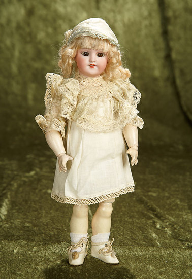 """12"""" German bisque child, """"Globe Baby"""", by Simon and Halbig. $400/500"""