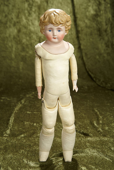 """17"""" German bisque doll with sculpted blonde hair. $300/400"""