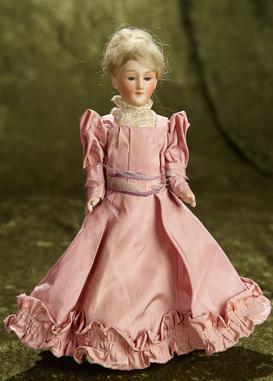 """9"""" German bisque lady doll, model 300, with closed mouth and original flapper body. $300/400"""