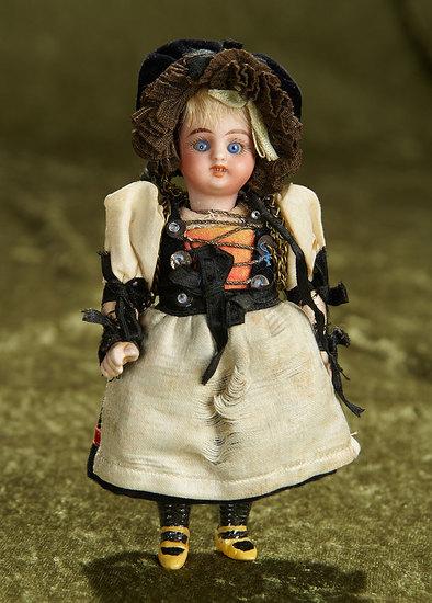 "6"" German bisque miniature doll in original folklore costume. $200/300"