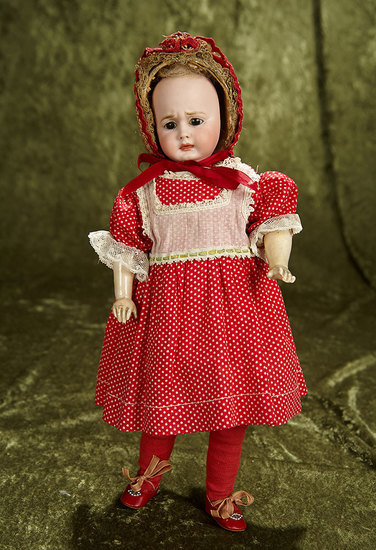"""12"""" German bisque two-faced doll by Carl Bergner with Simon and Halbig faces. $900/1100"""