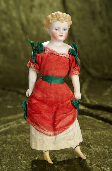 """9 1/2"""" German bisque doll with blonde sculpted hair and painted yellow boots. $300/400"""