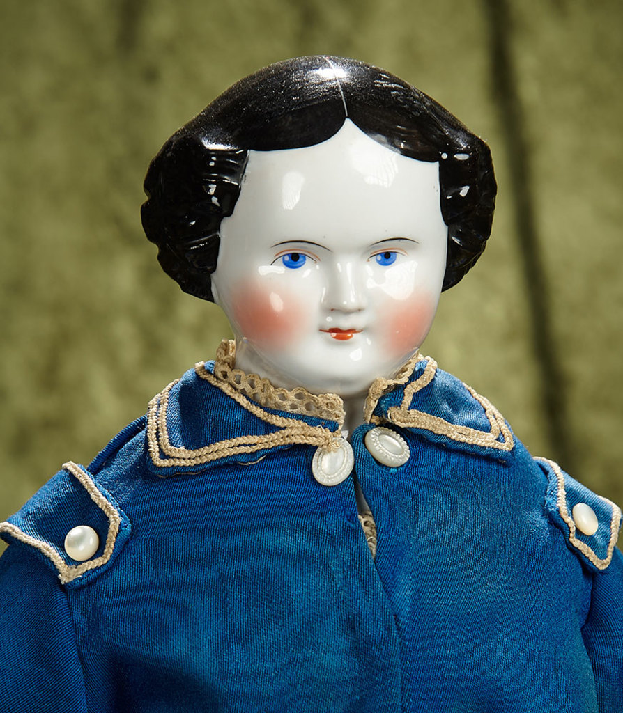 "22"" German porcelain doll with fine antique costume. $400/500"
