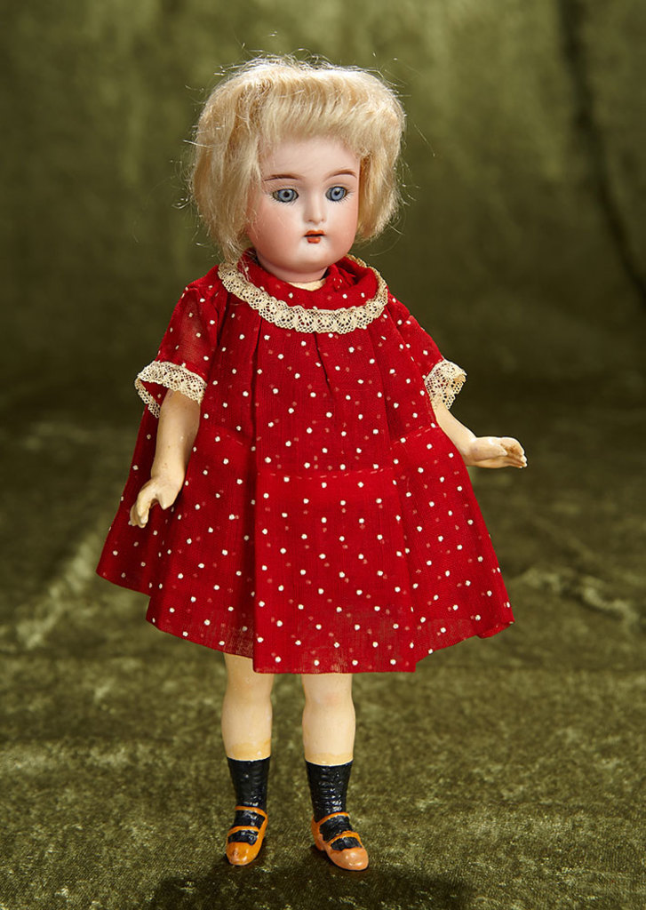 """9"""" German bisque flapper doll, walking style doll and original wig, Kammer and Reinhardt. $300/500"""