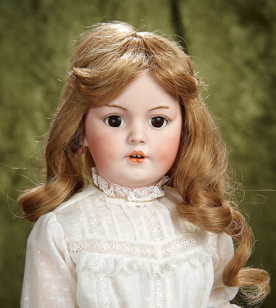 "20"" German bisque child, model 1279, Simon and Halbig, original body and body finish. $800/1000"