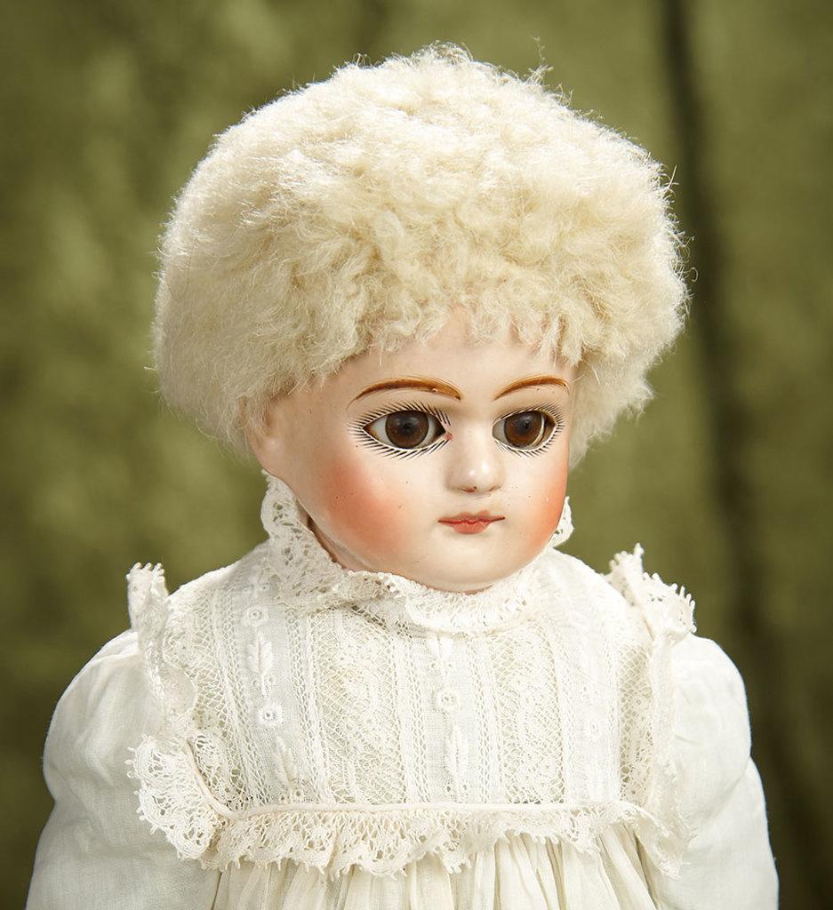 """13"""" German paper mache doll in fine original condition, antique costume. $400/500"""