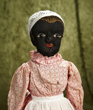American black cloth folk doll in the Beecher manner with shoe-button eyes. $400/500