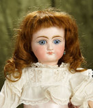 Sonneberg bisque doll with closed mouth by mystery maker. $600/800