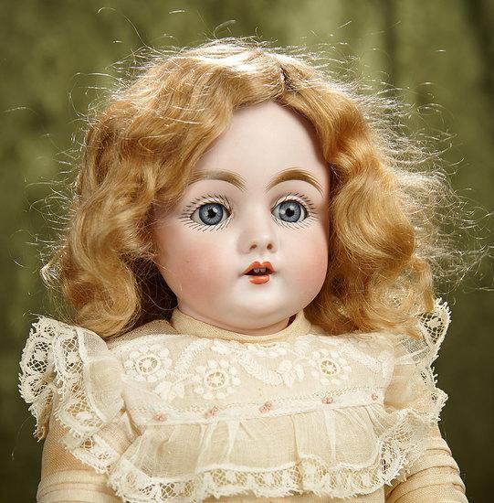 "14"" German bisque child doll, model 143, by Kestner with original signed body. $400/500"