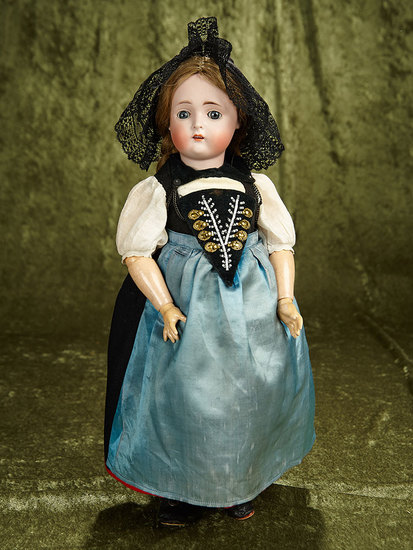 "18"" German bisque child doll, 136, by Kestner with wonderful original folklore costume. $400/600"
