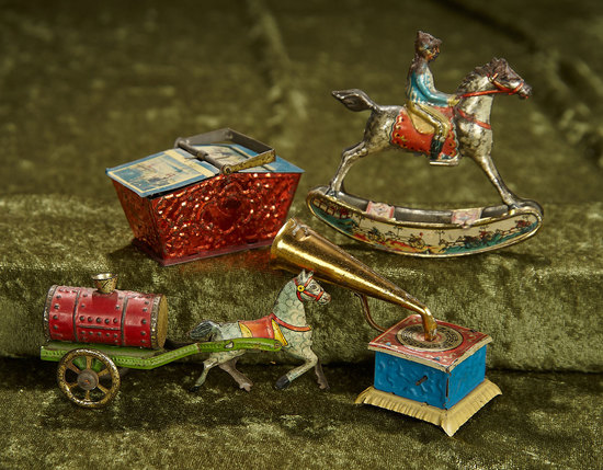 """Four German tin penny toys, 2 1/2""""-3"""", including mechanical Victrola. $300/400"""