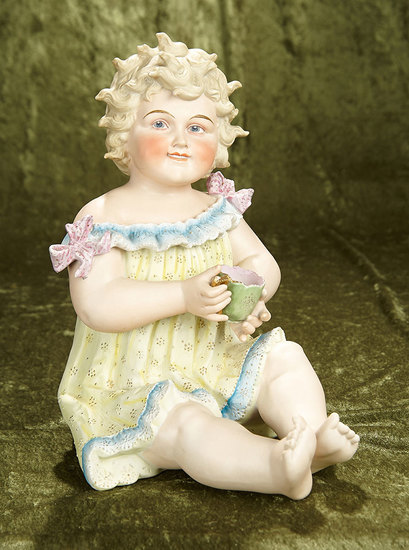 """14"""" seated. Rare grand-sized German all-bisque piano baby, tousled curly hair by Hertwig. $500/700"""