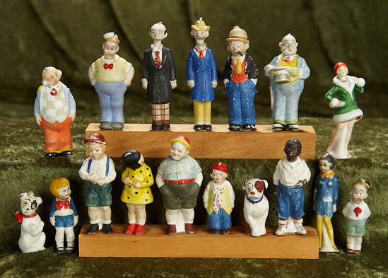 """Collection of Seventeen German all-bisque comic strip nodders, 2 1/2"""" - 4"""".  $400/500"""