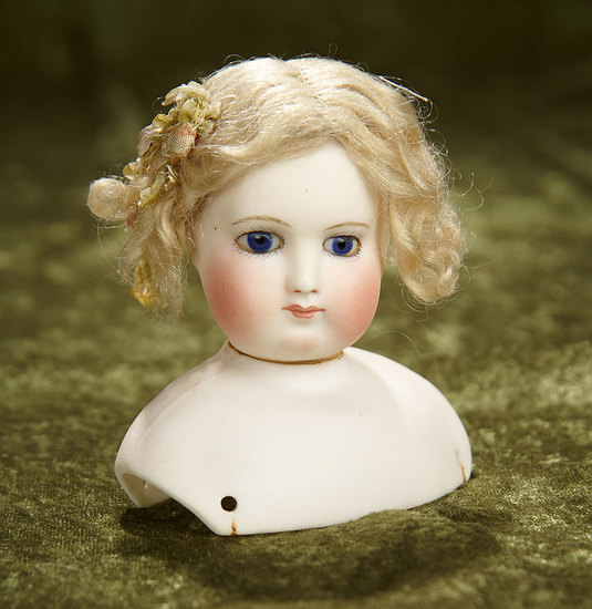 """3 1/2"""" French bisque poupee head, marked B.S., with beautiful cobalt blue eyes. $1000/1200"""