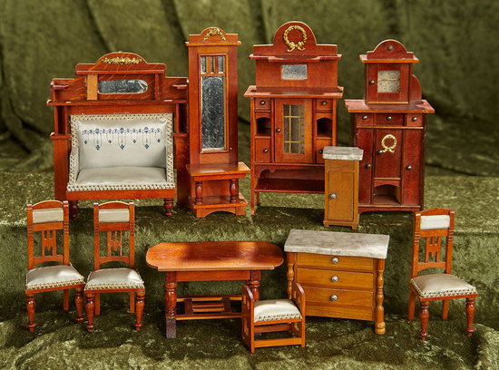 Collection of eleven wooden dollhouse furnishings with blue silk upholstery. $600/900