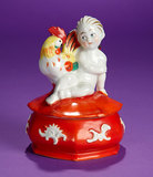 an Porcelain Seated Child with Rooster on Dresser Jar 200/300