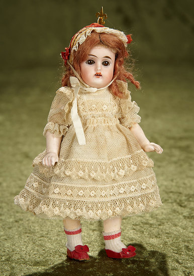 "Petite 7"" German bisque child, rare model 192, by Kammer and Reinhardt, lace costume. $400/500"