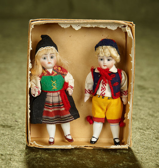 "4"" Two German All-Bisque Dolls in Original Folklore Costumes and Box. $300/400"