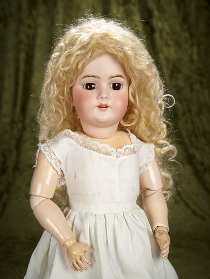 "22"" German bisque child doll, model 99, by Handwerck with original body and body finish. $400/500"