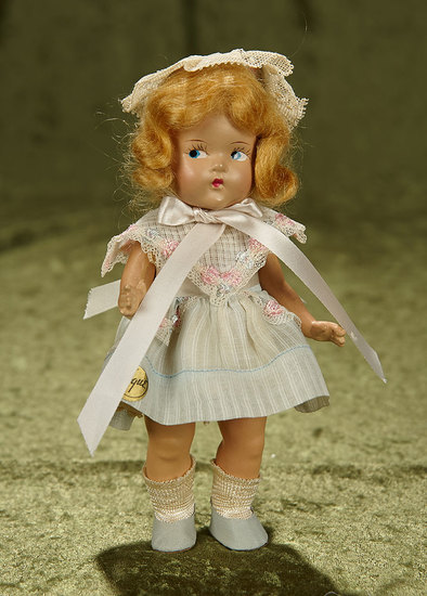 """8"""" Composition Toddles by Vogue in original blue costume, paper label, 1930s.$300/400"""