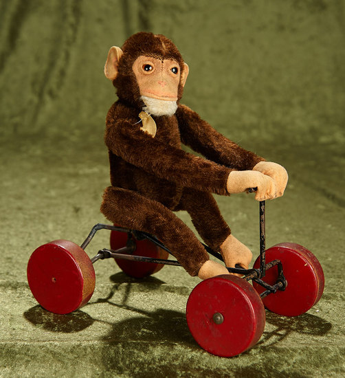"9""l. German mohair monkey on wheeled base with original US Zone cloth label by Steiff. $400/500"