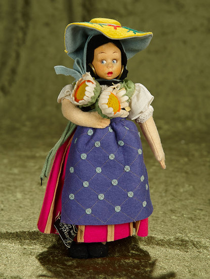 "9"" Italian felt miniature doll by Lenci with original costume and sunflowers. $400/500"