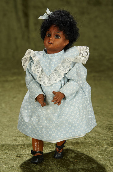 "9"" German brown-complexioned bisque doll with pretty antique costume. $300/400"