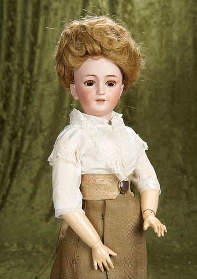 "25"" German bisque doll, model 1159, with shapely lady body for the French market. $1200/1600"