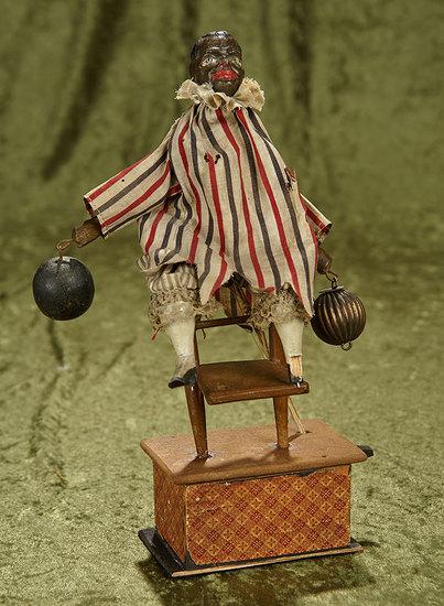 "12"" German black paper mache mechanical clown on chair. $400/500"