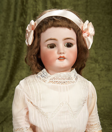 "28"" German bisque child by Bergmann with pretty antique costume. $500/700"