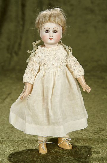 "10"" Sonneberg bisque closed mouth doll, model 106. $400/500"