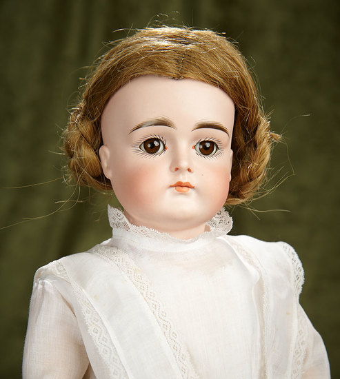 "18"" German bisque child by Kestner with closed  mouth. $1200/1500"