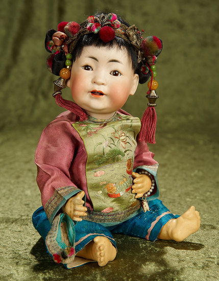 "13"" German bisque portrait of Chinese baby, model 243, by Kestner, antique costume. $1600/1900"