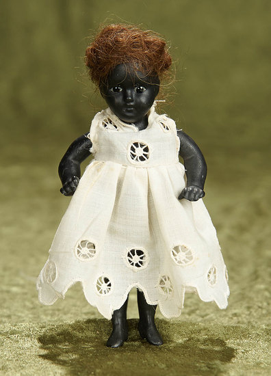 """5"""" German black-complexioned all-bisque doll. $300/400"""