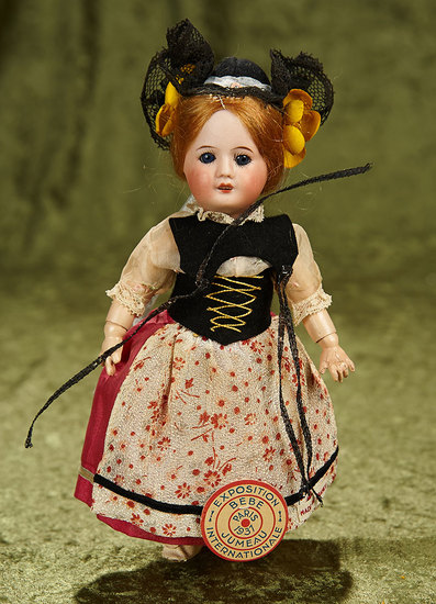 "8"" French bisque bebe in original folklore costume, rare Exhibition tag, original costume. $400/500"