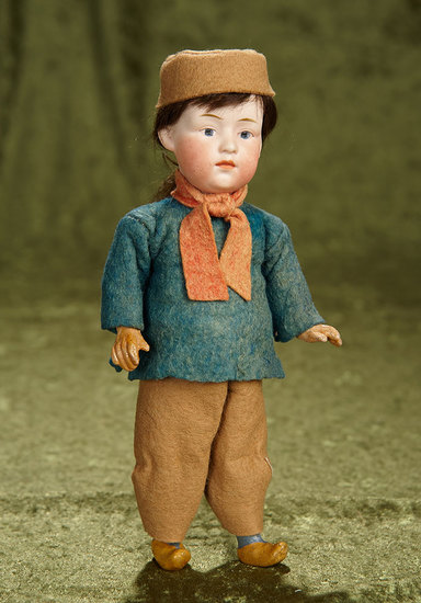 """9"""" German bisque painted eye character by Heubach with original factory costume. $300/400"""