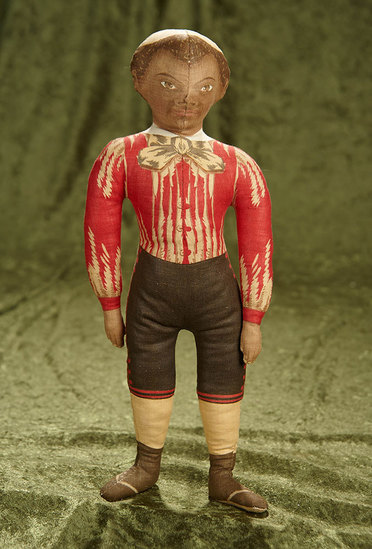 """14"""" American lithographed cloth doll of brown-complexioned boy by Ida Gutsell. $300/400"""