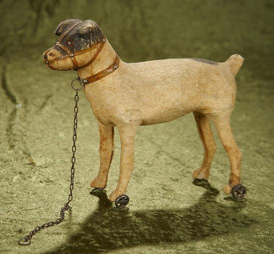 "9""l. German paper mache pull toy dog on wheels. $200/300"