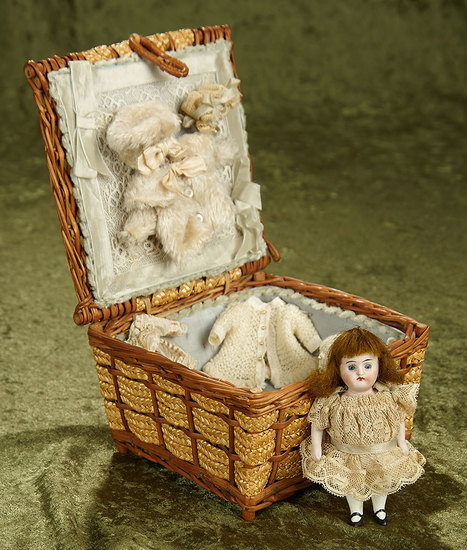 """4"""" German all-bisque miniature in woven basket with costumes. $400/500"""