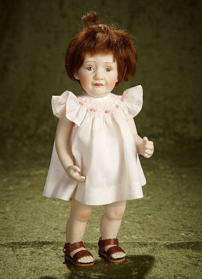 "11"" Porcelain doll with brunette bobbed hair and pink sundress by Beatrice Perini. $500/700"