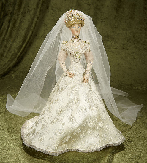 "16"" Porcelain Bride with elaborate coiffe by Kathy Redmond. $400/500"