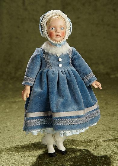 "13"" Porcelain doll with distinctive double-ruffled blue bonnet. $300/400"
